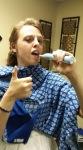 Erin brushing her teeth in her room